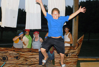 Walk the Plank at a Pirates and Mermaids Dance Kids In a Boat While One Boy is Going Off The Plank
