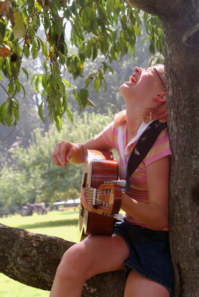 Flexible 2, 4, 6 and 8-Week Sessions Girl Playing Guitar Sitting On Tree Limb