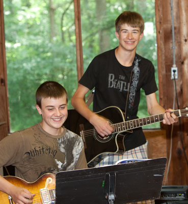 rock camp jam at sleepaway summer camp NJ Two boys Playing Guitars On Stage
