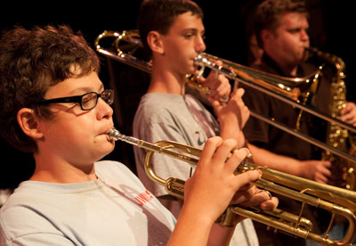 Performance Opportunities in Classical, Jazz, and Rock Music Boy Playing Trumpet. Boy Playing Trombone.