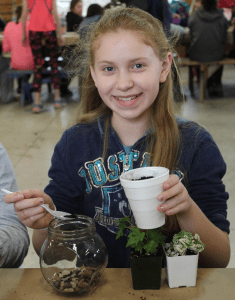 Girl Scout making crafts at Appel Farm