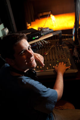 Boy working on Audio Equipment during a Performance