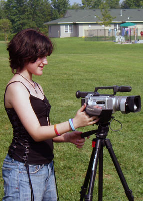 Producing, screenwriting, directing, filming and editing Girl outside shooting video